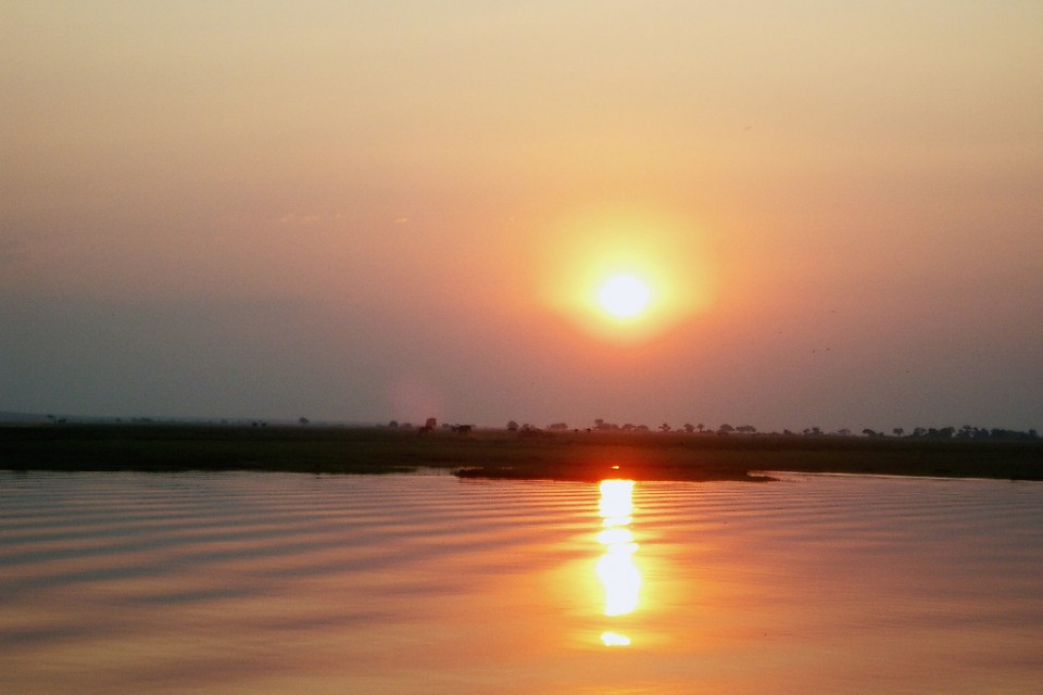 Sunset over the Chobe River  by Paul Makinen